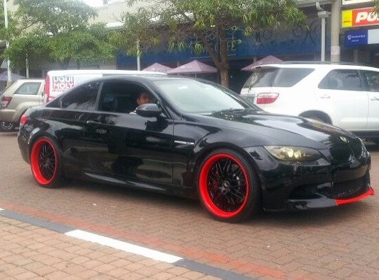 Photo Black Bmw M3 With Neon Orange Rim Trim And Front Lip