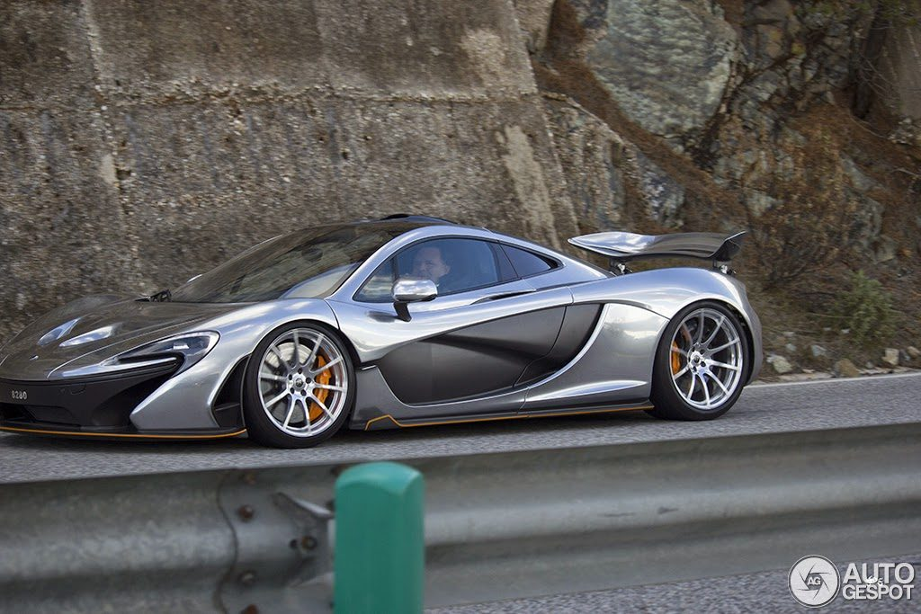 mclaren p1 silver. this silver example has had delicate touches of mclaren orange applied to the carbon lips and edges even though these components are small in relation mclaren p1